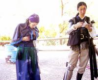 I adjust my costume. Devin looks cool in armor.